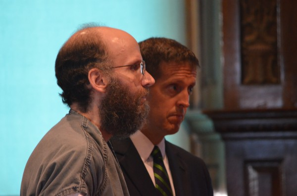 Christopher Knight, left, stands with his attorney, Walter McKee, at Kennebec County Superior Court in Augusta on Tuesday. He pleaded not guilty to theft and burglary charges.