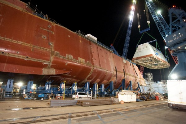 The 900-ton composite deckhouse of the DDG 1000 warship under construction at Bath Iron Works is hoisted onto to the hull of the ship on December 14, 2012, in Bath.