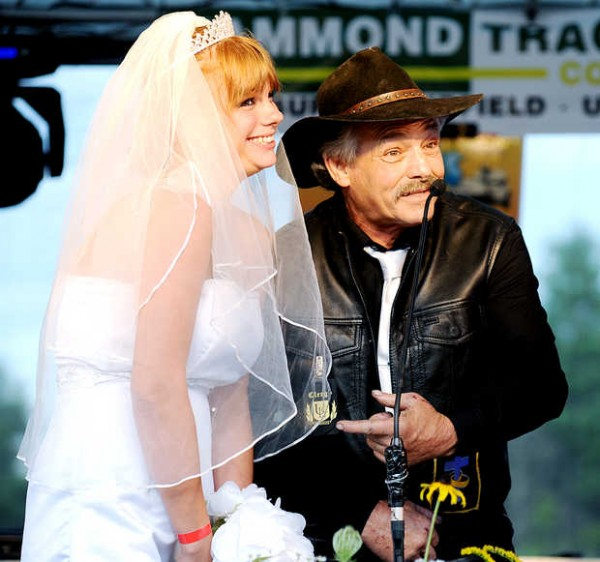 Rev. Roland &quotYummy&quot Raubeson of Minot jokes with Lucretia (Blais) Gould of Lewiston during the wedding ceremony at the Redneck &quotBlank&quot in Hebron on Saturday.