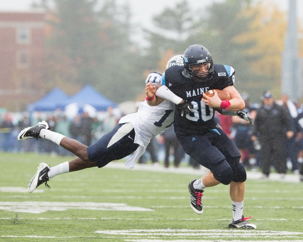 Justin Perillo (80) breaks a tackle attempt by Tre Williams (11) on his way to his second touchdown of the first half during the UMaine football game against UNH on Saturday, Oct. 20, 2012.