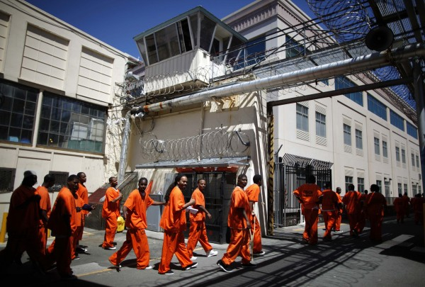 Inmates walk in San Quentin state prison in San Quentin, Calif., in this June 8, 2012 file photo.