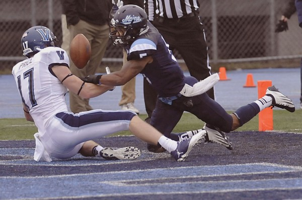 Maine defensive back Kendall James (5) breaks up a pass intended for Villanova receiver Joe Price (17) in the first half of their football game in Orono, Maine, Saturday, September 29, 2012.