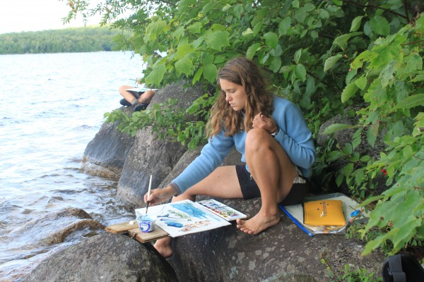 Ivy Enoch, 17, of Farmington, paints the view of Katahdin on Aug. 10, 2013, from her viewpoint sitting on a rock at the edge of Katahdin Lake in Baxter State Park. The watercolor lesson was a part of the Maine Youth Wilderness Leadership Program, a nine-day backpacking trip in the park with nine other Maine high school students and two Chewonki trip leaders.