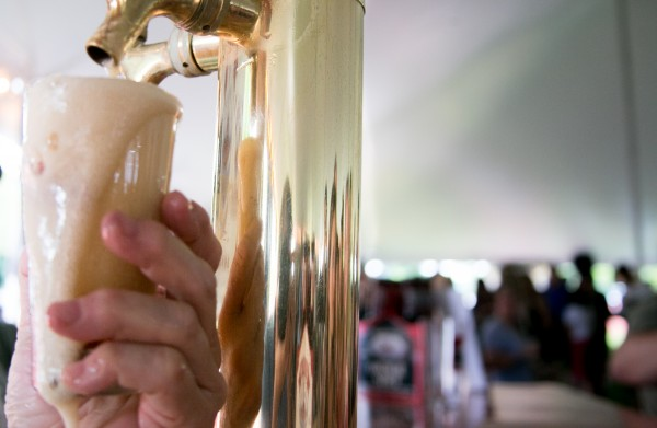 A Belfast Bay Lobster Ale overflows a glass at the Bangor Beer Festival in this June 2013 file photo.