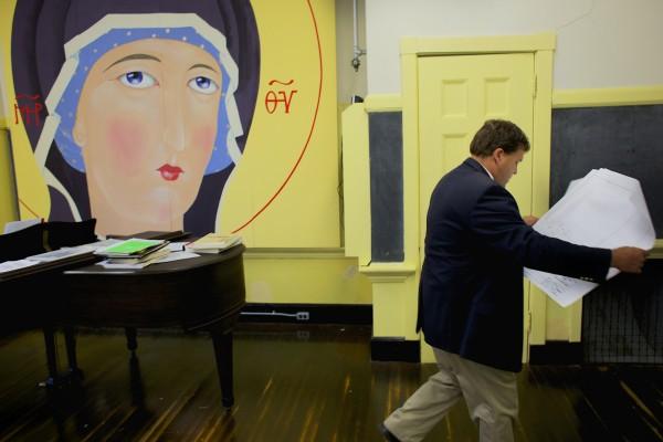 Auctioneer Stef Keenan looks over building schematics of the Peirce School in Belfast.