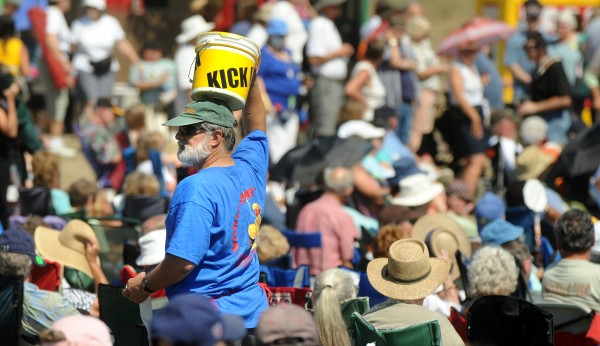 Joe Grzybowski of Bangor walks through the crowd collecting donations for the American Folk Festival in 2010.