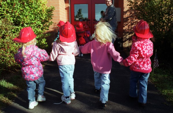 Children from Stepping Stones make their way into the Hampden Municipal building where they will visit the fire station on a scheduled field trip Tuesday, Oct. 8, 2002.