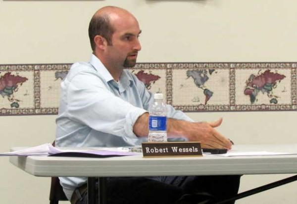 Paris Selectman Robert Wessels explains his cost-cutting program at the board meeting Monday evening.