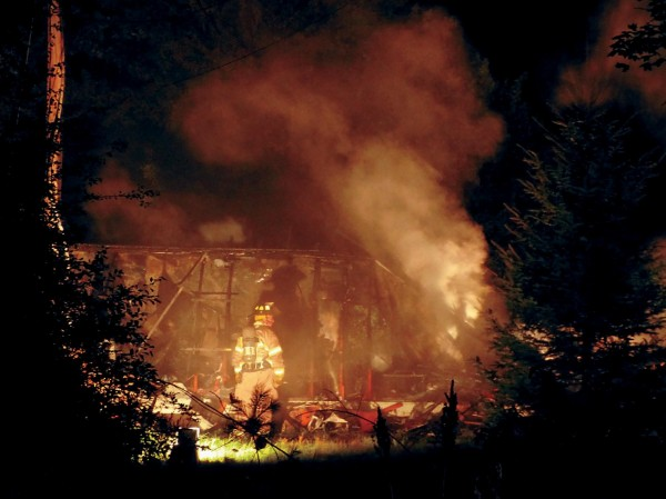 A firefighter looks over the smoldering remains of a mobile home on Kimball Street in Richmond early Monday morning. The fire was reported at 11:30 p.m. Sunday. Crews from Richmond, Bowdoinham and Dresden were on scene. Bowdoin Fire Department provided station coverage.