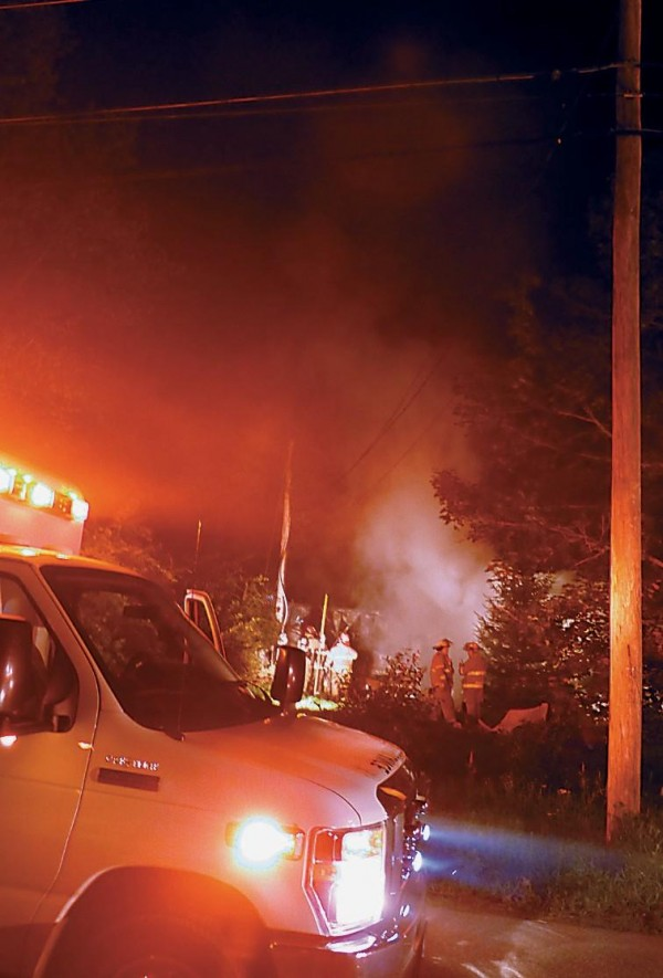 Fightfighters examine the damage to a mobile home on Kimball Street in Richmond early Monday morning. The fire was reported at 11:30 p.m. Sunday. Crews from Richmond, Bowdoinham and Dresden were on scene. Bowdoin Fire Department provided station coverage.