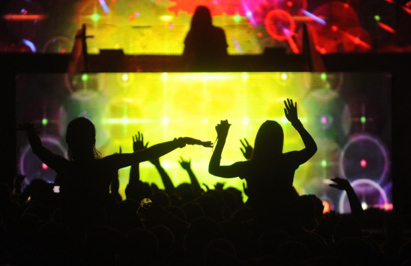 BDN photo by John Clarke Russ  Revelers are silhouetted against the colorful light display of freeform dubstep electronic artist Lorin Ashton, better known as Bassnectar, who performed at KahBang on Bangor's waterfront Saturday night, Aug. 11, 2012.