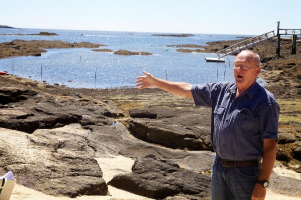 Bud Brown of Eco-Analysts Inc. talks to a crowd of people about a proposed dredging project in a cove on Southport Island Thursday.