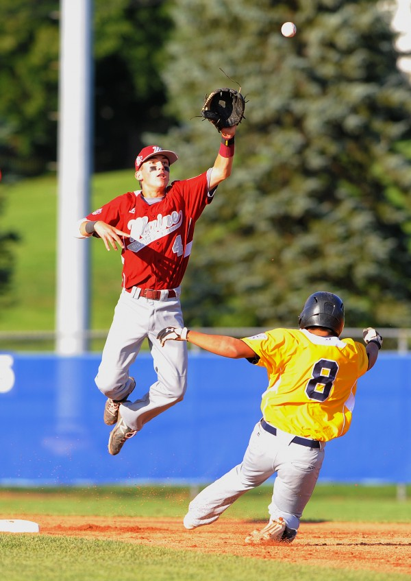 Maine District 3's Kyle Stevenson jumps off second base to make the catch as the U.S. West's Sanyo Lo slides safely to second base during a Senior League World Series game at Mansfield Stadium in Bangor Thursday. Lo was safe on the play.