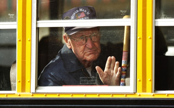 World War II veteran Harold Beal of Southwest Harbor waves to the crowd gathered on Main Street as the Bangor Brewer Veterans Day Parade passes through downtown Bangor on November 11, 2008.
