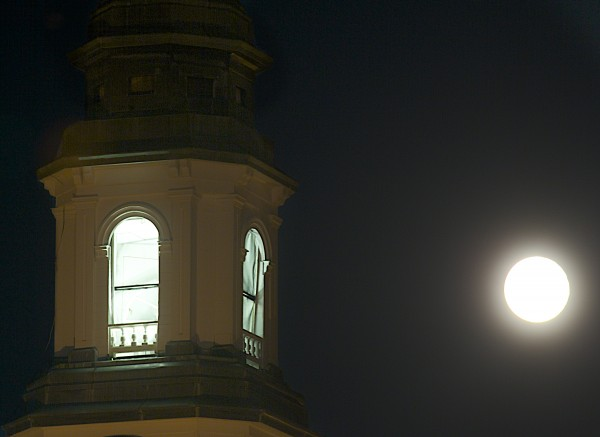 The moon shines bright next to the Hammond Street Congregational Church on Wednesday evening the day after the &quotblue moon&quot arose in the sky which was on Tuesday, August 20 2013. A blue moon refers to the second full moon that occurs within one month.