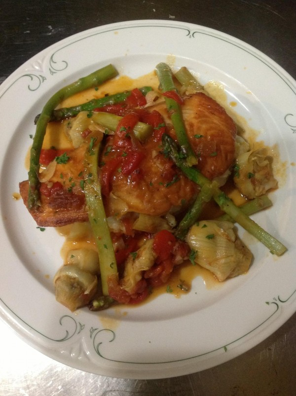 Salmon Barese, with artichokes and tomatoes, at Vittles Restaurant in Pittsfield.