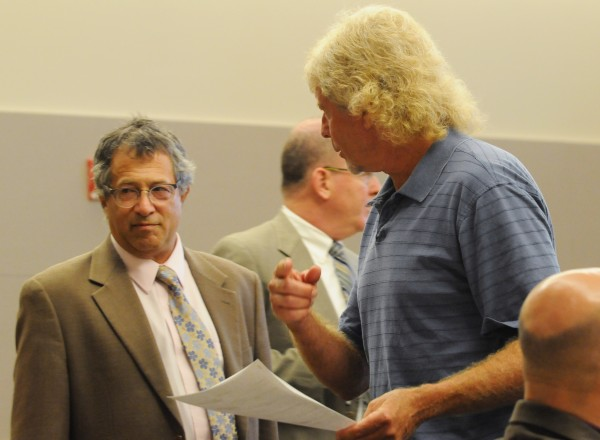 Dana Wilson, right, fired his attorney Jeffrey Silverstein, left, and requested a court appointed attorney from Justice William Anderson on Tuesday at the Penobscot Judicial Center in Bangor.