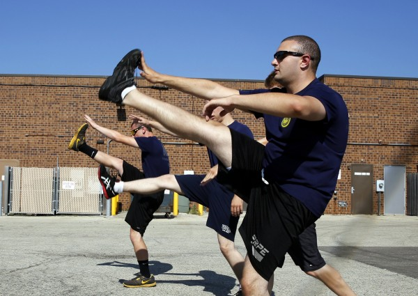 Herschel Gilbert (right), 20, leads three other future sailors in their daily physical training regimen at the Armed Forces Recruiting Center on July 17, 2013, in Crystal Lake, Illinois. Gilbert weighed more than 250 pounds when he first visited a recruiter last year.