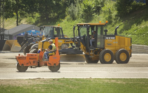 Construction crews make improvements to the concert grounds at Darling's Waterfront Pavilion on Aug. 1 in Bangor after complaints of a foul smell coming from the organic loam underneath the grass.