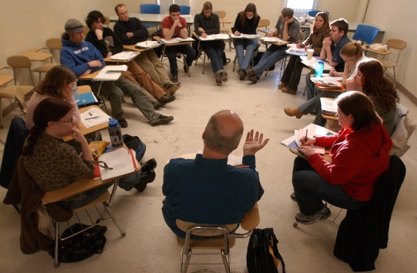 Professor Wesley McNair talks to students during an advanced poetry writing class at the University of Maine at Farmington.  Many students chose to go to the small college because of its small student-to-faculty ratio and fine reputation among small colleges of its king in the Northeast. The school received high rating for seven years in the U.S. News and World report ranking of colleges and universities.