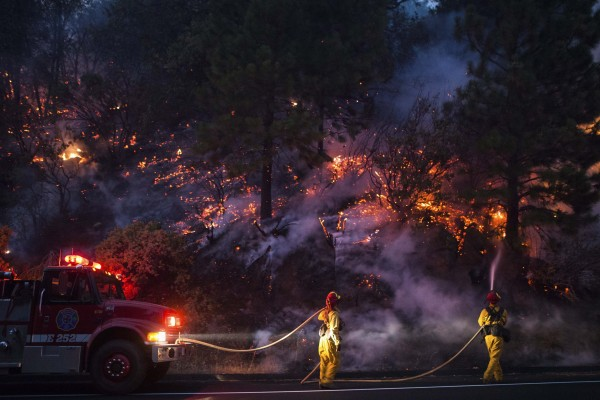 Firefighters work to prevent the Rim Fire from jumping Highway 120 near Buck Meadows, Calif., on Saturday.