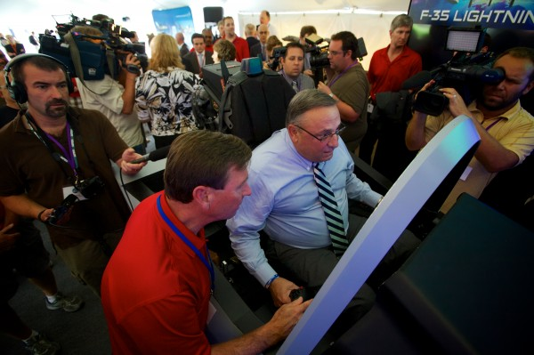 Governor Paul LePage flies an F-35 Lightning II simulator at a Pratt & Whitney employee appreciation event in North Berwick Friday morning. The Pratt & Whitney facility manufactures the F-35's engine.