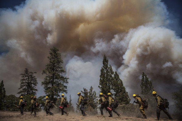 Los Angeles County firefighters hike in on a fire line on the Rim Fire near Groveland, Calif., on Thursday.