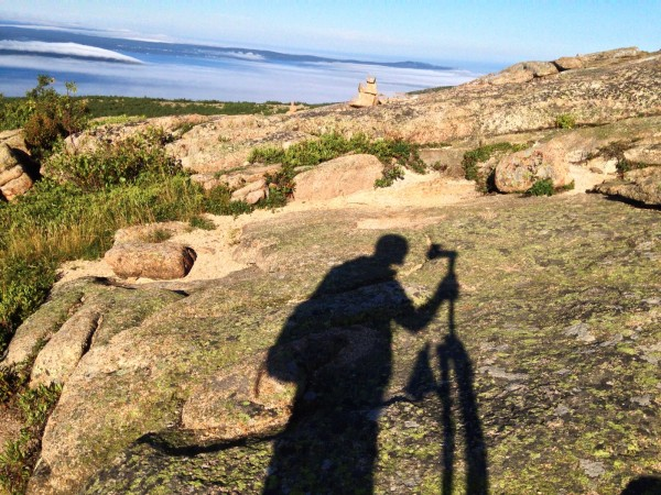 Ross Milby, co-owner of Terrain360, catches an image of his shadow while shooting photos of Acadia National Park in July 2013 for Terrain360.com.
