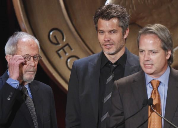 Executive producer Graham Yost speaks in front of actor Timothy Olyphant (C) and writer Elmore Leonard (L) after receiving a Peabody award for their work in &quotJustified&quot during the 70th annual Peabody Awards ceremony in New York in this May 23, 2011 file photo. U.S. novelist Elmore Leonard, known for gritty crime dramas including &quotGet Shorty,&quot has been hospitalized in the Detroit area after suffering a stroke last week, the author's longtime researcher said August 6, 2013.