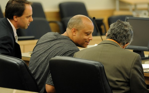 Randall &quotRicky&quot Daluz sits with his attorneys Hunter Tzovarras (left) and Jeffrey Silverstein (right) at a hearing on a motion to try Daluz and Nichloas Sexton separately.  Daluz and Sexton are accused of killing three people in Bangor last year.