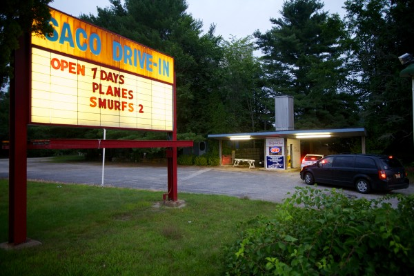 Car loads of people trickle into the Saco Drive-In theater Tuesday night. The owners of the drive-in, which first opened in 1939, are trying to win a national contest that will get them a brand-new digital projector, allowing them to open next season.