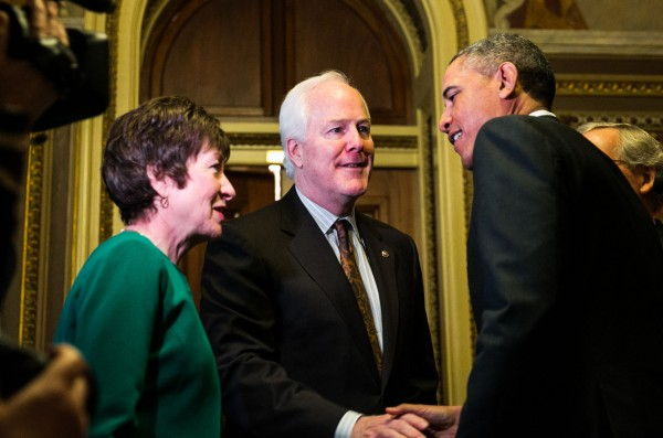 President Barack Obama is greeted by Senators Susan Collins, R-Maine, and John Cornyn, R-Texas, as he arrives at the U.S. Capitol to meet with Senate Republicans on Capitol Hill in Washington, D.C., in this March 2013 file photo.