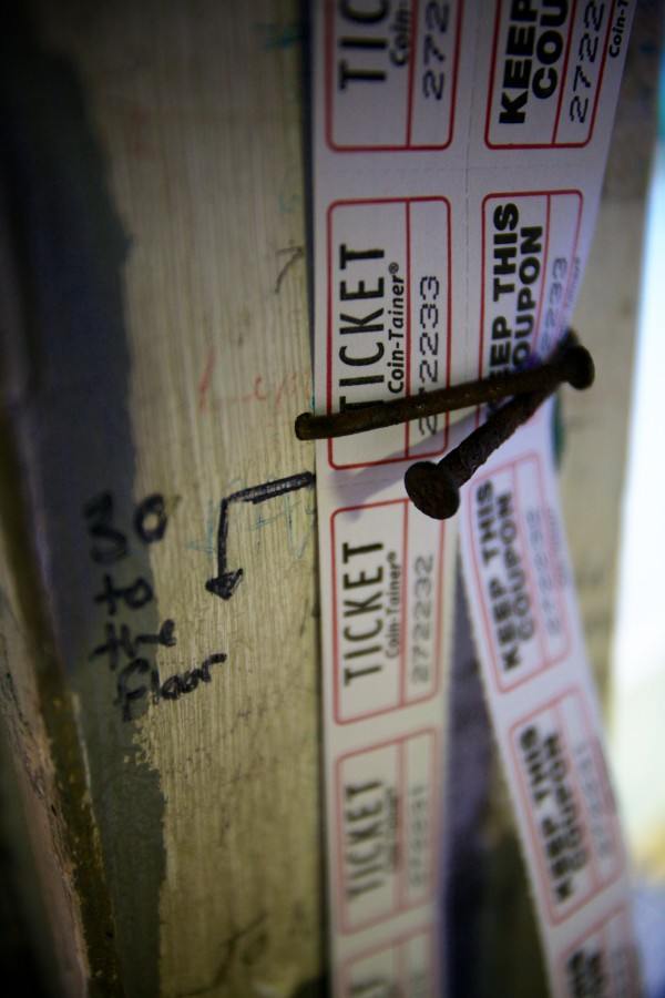 Age-old nails keep the tickets in order in the Saco Drive-In theater ticket booth Tuesday night. The owners of the drive-in, which first opened in 1939, are trying to win a national contest that will get them a brand-new digital projector, allowing them to open next season.