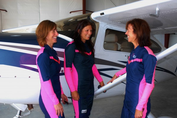Three members of the Misty Blues (from left), Kim Kanat, Kristal Ciamillo and team leader Cindy Irish, talk next to one of the planes at the Northern Aroostook Regional Airport. The all-female sky-diving team arrived in Frenchville late Friday afternoon and have four scheduled jumps as part of the weekend's Frenchville Fly-in & Air Show.