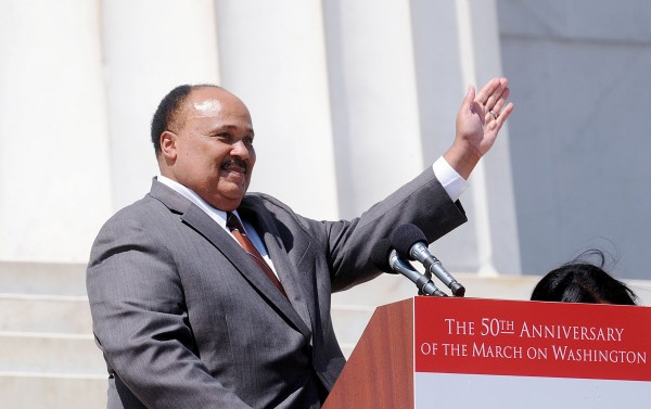 Civil rights leader Martin Luther King III, the eldest son of Dr. Martin Luther King Jr., waves to the crowd from the steps of the Lincoln Memorial during a  celebration of the 50th anniversary of the March on Washington in Washington, D.C., Saturday, August 24, 2013.