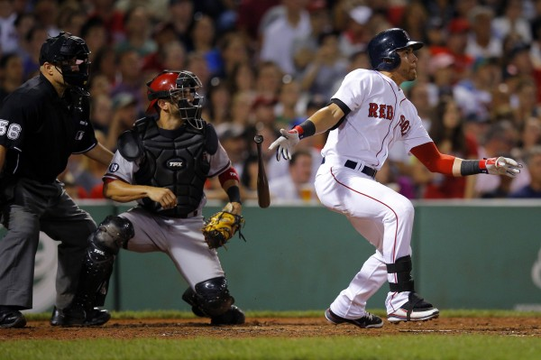 Arizona Diamondbacks catcher Wil Nieves and Boston's Jacoby Ellsbury watch Ellsbury's RBI single in the seventh inning of their  game at Fenway Park in Boston Saturday night. The Red Sox beat Arizona 5-2 and won 4-0 on Sunday when Ellsbury drove in two runs.
