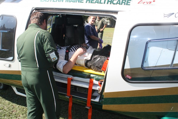 A LifeFlight employee and rescue personnel attend to Scott Killton as he lays inside a LifeFlight helicopter.