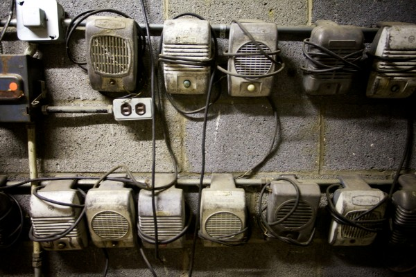 Old window speakers line the walls in the projectionist's booth at the Saco Drive-In theater Tuesday night. The owners hope to keep it going next year by winning a contest that will get him a new digital projector, eliminating the need for film or a projectionist.