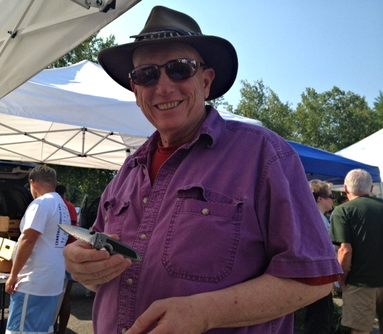 Tom Peterson of Windham, Maine is happy with the new edge on his pocket knife. David Orbeton of Wicked Sharp is a Falmouth Farmer's Market mainstay.