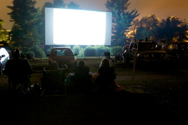 Cars and lawn chairs line the grounds at the Saco Drive-In Tuesday night where movies have been lighting up summer nights since 1939. The theater is the second-oldest operational drive-in in the country and the owners hope to keep it going next year by winning a contest that will get him a new digital projector.