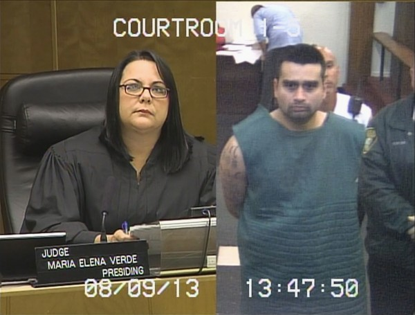 Judge Maria Elena Verde presides over the bond hearing for Derek Medina (right) appearing via closed-circuit TV shown here in this Dade County Courthouse video still in Miami, Fla., on Friday. Medina, who reportedly posted a photo of his wife's body on Facebook after killing her, turned himself in to authorities on Thursday and confessed to the slaying, police said.
