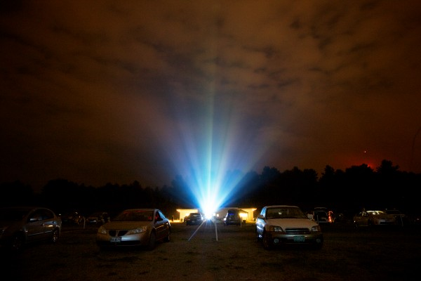 Cars line the grounds at the Saco Drive-In Tuesday night where movies have been lighting up summer nights since 1939. The theater is the second-oldest operational drive-in in the country and the owners hope to keep it going next year by winning a contest that will get him a new digital projector.