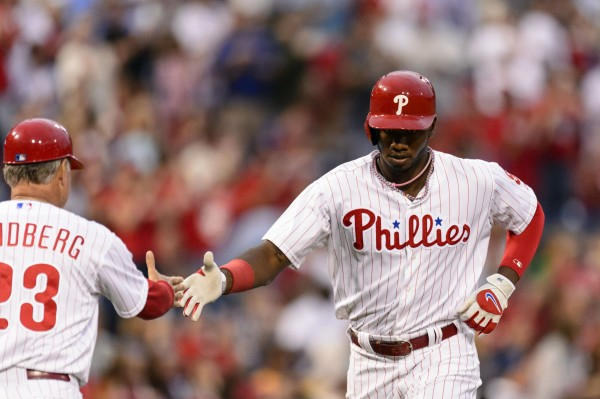 Philadelphia Phillies left fielder Domonic Brown (9) celebrates hitting a home run with third base coach Ryne Sandberg (23) during the second inning against the Chicago Cubs at Citizens Bank Park. Brown played for Dade City, Fla., during the 2004 Senior League World Series in Bangor.