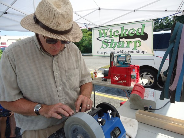 David Orbeton of Wicked Sharp gives people their edge back at the Falmouth Farmers Market.