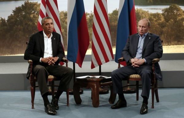 File photo of U.S. President Barack Obama meeting with Russian President Vladimir Putin during the G8 Summit at Lough Erne in Enniskillen, Northern Ireland June 17, 2013. Obama cancelled a meeting with Putin planned for next month in Moscow over frustration with Russia's asylum for fugitive intelligence contractor Edward Snowden, the White House said August 7, 2013.
