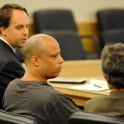Judge considers separate trial for men charged in triple homicide last year