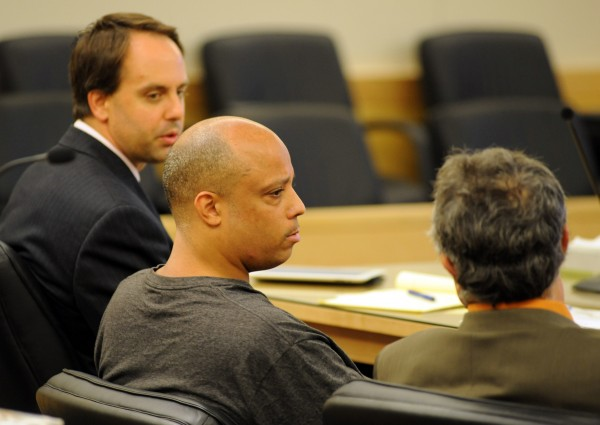 Randall &quotRicky&quot Daluz sits with his attorneys Hunter Tzovarras (left) and Jeffrey Silverstein (right) at a hearing on a motion to try Daluz and Nichloas Sexton separately Thursday.