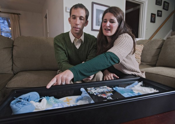 John, left, and Jenny Mohler look at a keepsake box of their son on March 26, 2013, at their Catonsville, Maryland home. They were the parents of Joseph Angelo, born December 13, 2012, who lived for an hour.
