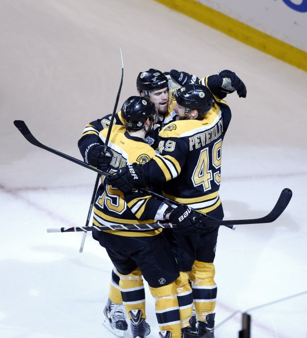 Boston Bruins center Rich Peverley (49) celebrates with center Rich Peverley (49) and center Tyler Seguin (19) after scoring a goal against the Chicago Blackhawks during the first period in game four of the 2013 Stanley Cup Final at TD Garden in June.