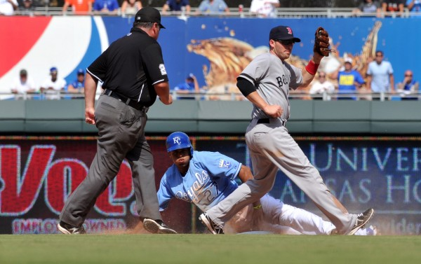 Kansas City Royals base runner Justin Maxwell (27) gets tagged out attempting to advance to second base by Boston Red Sox shortstop Stephen Drew during the eighth inning at Kauffman Stadium Sunday.  The Royals won 4-3.